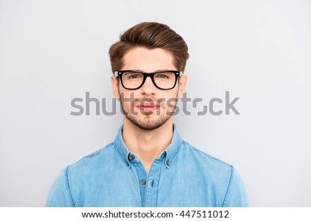 Portrait of serious calm minded businessman wearing glasses #447511012