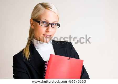Portrait of serious looking business woman with folders isolated on white background.