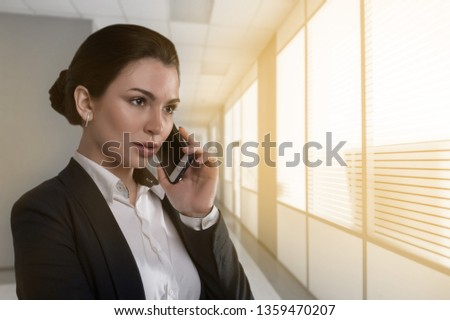 Happy Businesswoman Talking On The Phone In An Office Images