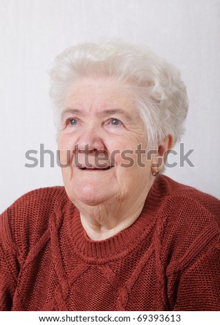 Portrait of serious senior woman in her room