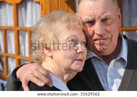 Portrait of serious thinking elderly couple closeup