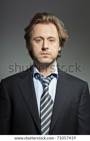 Portrait of serious young business man. Studio photo. Thought. Thinking. In mind. Concentration.