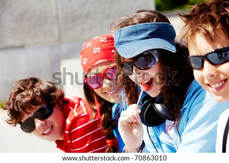 Portrait of several modern teens looking at camera at leisure