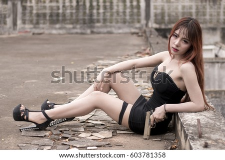 Portrait Of Sexy Asian Woman And Handgun In Old Building 603781358