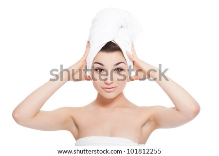 portrait of sexy beautiful young woman wrapped in towel body and head, isolated over white background concept of natural beauty care skin, hair, spa bath