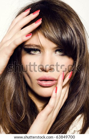 Portrait of sexy girl. Pretty sensual woman face with manicured fingers