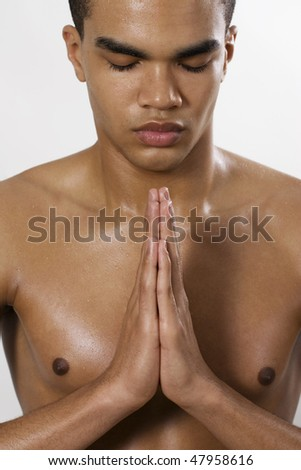 Portrait of sexy man meditating