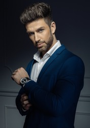 Portrait of sexy man with watch