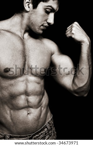 stock photo : Portrait of sexy muscular man showing his biceps