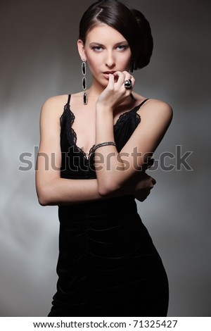 portrait of sexy slim woman in black dress