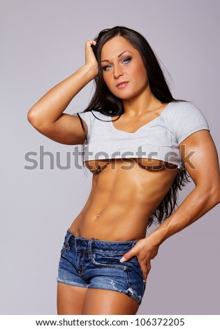 stock-photo-portrait-of-sexy-woman-posing-in-studio-in-clothes ...