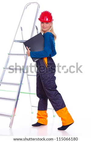 Portrait of sexy woman posing in studio on ladder