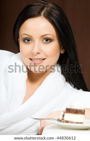Portrait of sexy woman with piece of chocolate cake