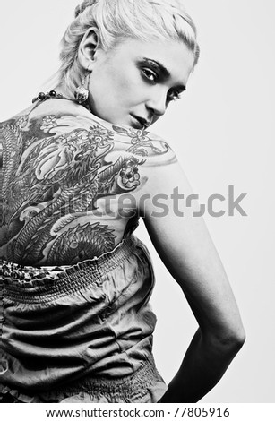 stock photo : portrait of sexy woman with tattoo on her back. Black-white