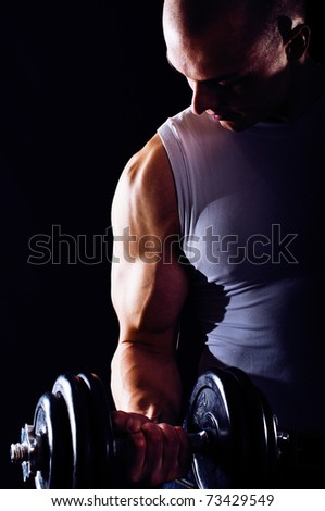 Portrait of sexy young man showing his muscular arm