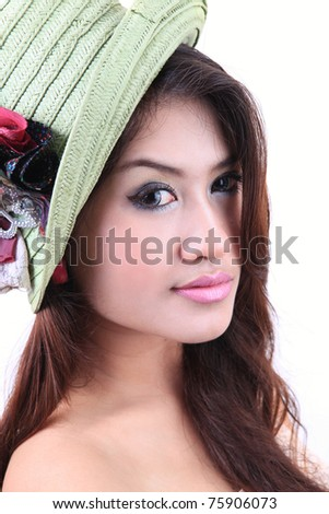 Portrait of sexy young woman in hat