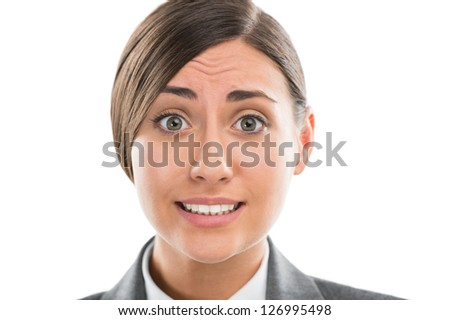 Portrait of shocked and confused business woman on white background