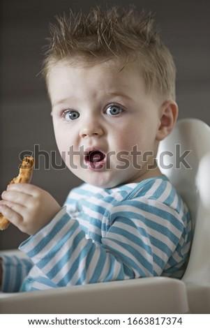 Portrait of shocked baby boy