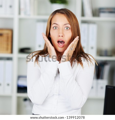 Portrait of shocked businesswoman in formals at office