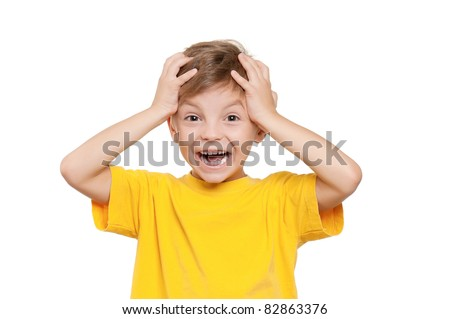 Portrait of shocked little boy with hands on head over white background - stock photo