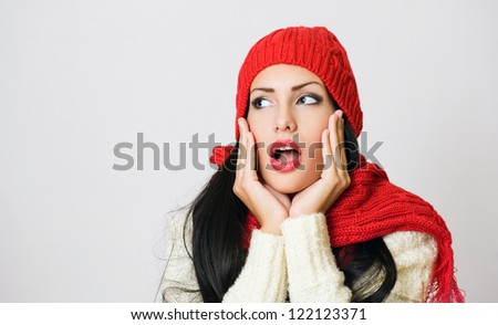 Portrait of shocked looking gorgeous brunette fashion girl.