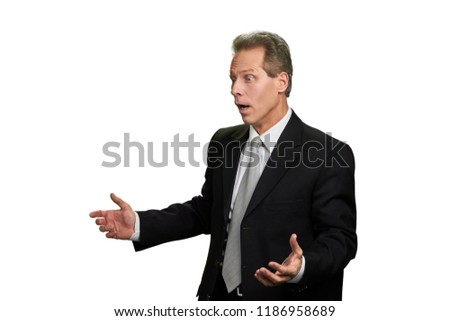 Portrait of shocked middle-aged businessman. Surprised man in formal wear gesturing with hands on white background.
