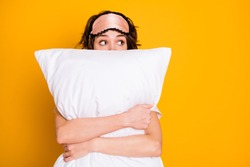 Portrait of shocked terrified girl see nightmare embrace her soft pillow look copyspace wear pajama eye mask isolated over bright shine color background
