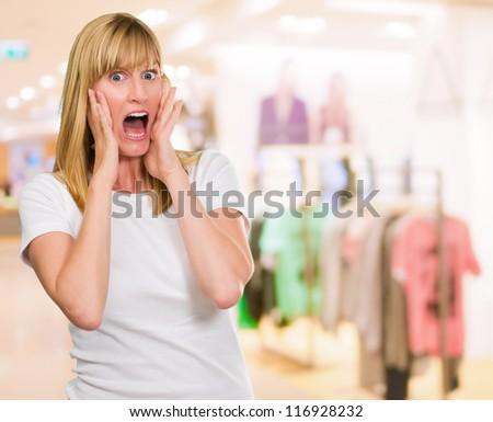 Portrait Of Shocked Woman at a clothes shop
