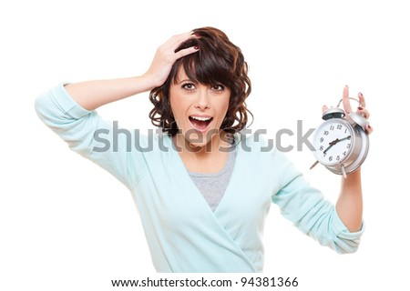 portrait of shocked woman with alarm clock over white background
