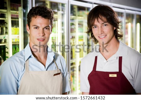 Portrait of shop assistants in a supermarket