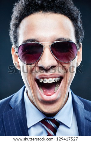 Portrait of shouting man in sunglasses looking at camera