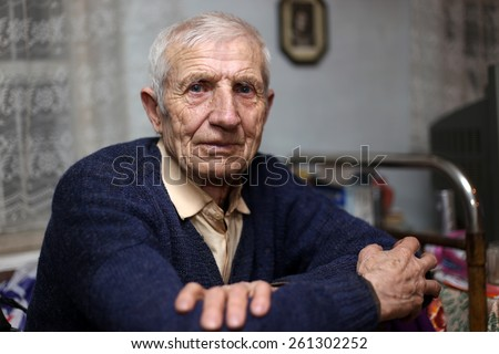 portrait of  sitting senior man at home  #261302252