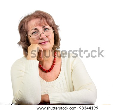Portrait of sitting senior woman with glasses isolated on white