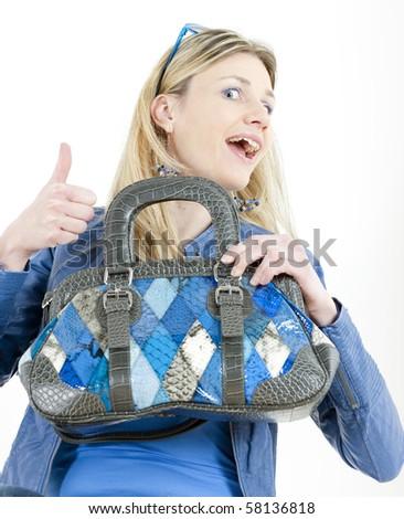 portrait of sitting woman with handbag