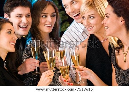 Portrait of six happy people holding glasses of champagne making a toast