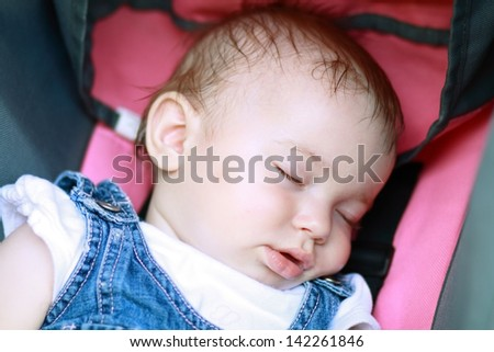 portrait of sleeping baby girl in pram #142261846
