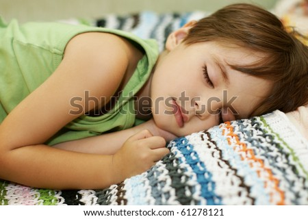 Portrait of sleeping cute little boy