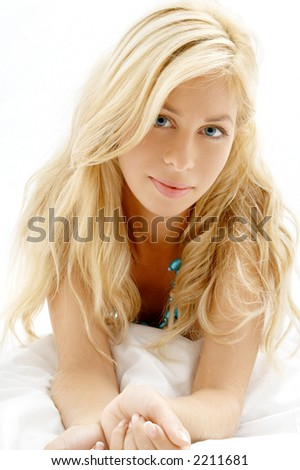 portrait of sleepy blond laying in bed