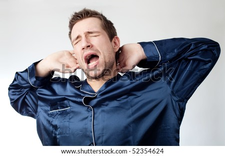 Portrait of sleepy man yawning - stock photo
