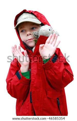 Portrait of small boy in red jacket with toy lambkin isolated on white with included clipping path