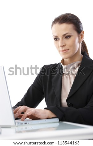 Portrait of smart businesswoman concentrating on computer work, looking at screen, isolated on white.