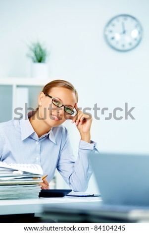 Portrait of smart businesswoman working in office