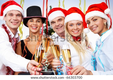 Portrait of smart colleagues with flutes of champagne celebrating Christmas