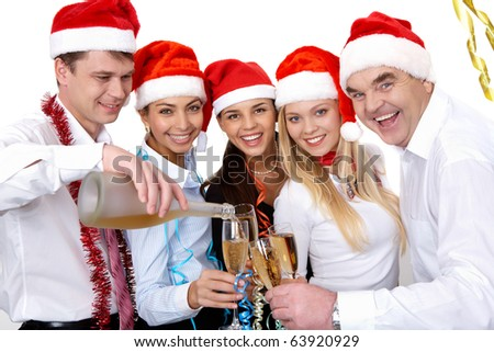 Portrait of smart colleagues with flutes of champagne while toasting
