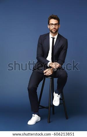 Portrait of smart man in suit, studio
