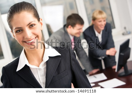 Portrait of smart manager in working environment at meeting in the office