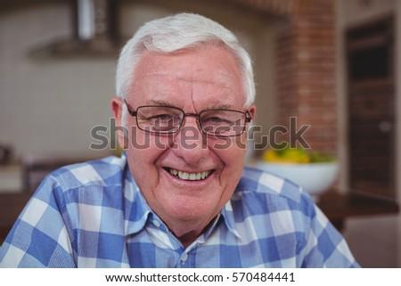 Portrait of smart senior man in kitchen #570484441