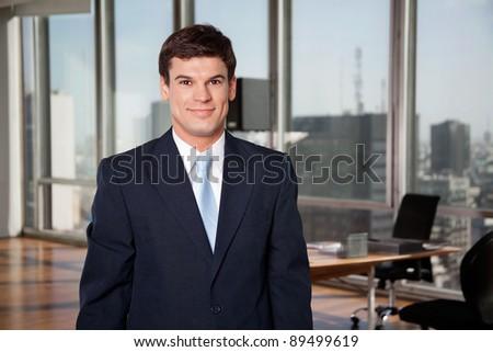 Portrait of smart well-dressed male entrepreneur smiling