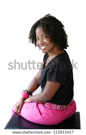 Portrait of smiling African-American girl on white background