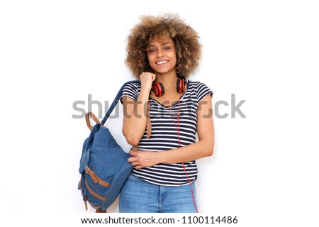 Portrait of smiling african american young woman with bag against white background #1100114486